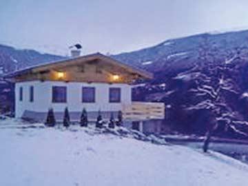 Hütte Aschau an der Piste, im Sommer im Wandergebiet