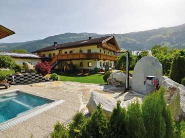 Ferienwohnung Aschau Tirol mit Fass-Sauna und eigenem Garten