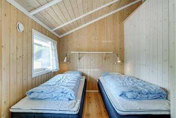 Schlafzimmer mit 2 Einzelbetten, die als Doppelbett zusammengestellt werden können
