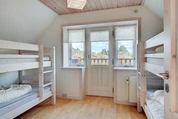 das 4-Bett-Zimmer mit Etagenbettem