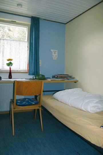 Büro mit einem Einzelbett