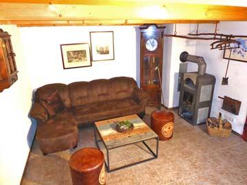 Ferienhaus Ruhpolding - Wohnzimmer mit Schwedenofen