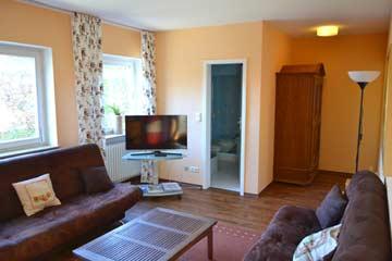 Wohnzimmer mit Schlafmöglichkeit
