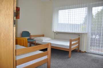 2-Bett-Zimmer mit Balkon