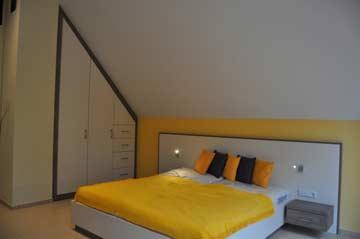 Schlafzimmer 3 mit Doppelbett im DG