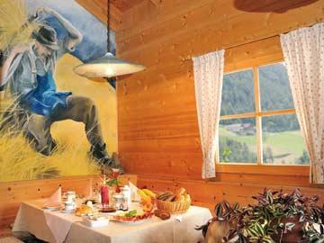 Ferienwohnung Rosengarten Latemar - in der Holzblockhütte