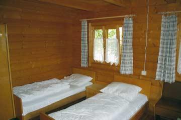 Schlafzimmer im Holzchalet