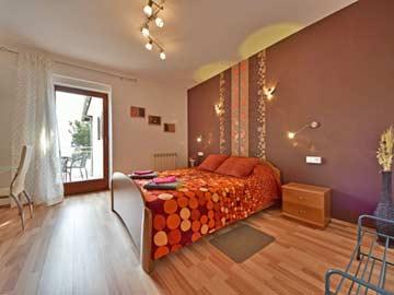 Schlafzimmer 1 - Doppelbett mit Terrasse