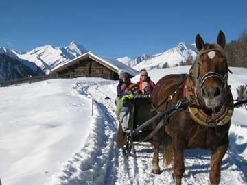Pferdeschlittenfahrt vom Haus