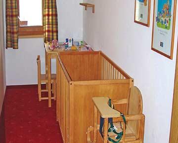 Ferienhaus Pass Thurn - Komfort auch für die Kleinsten: gute Kleinkindausstattung mit Babybett und Hochstuhl