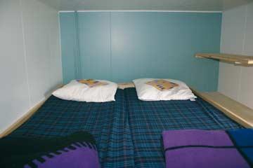 das Doppelhochbett im 3-Bett-Zimmer im OG