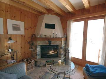 Ferienhaus Les Collons - Wohnraum mit offenem Kamin